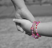 holding childs hand by Jodie E
