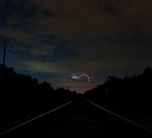 Lightning Strikes Over the Manchaca RailRoad Tracks by Roschetzky