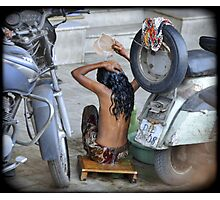 Girl, washing in the streets of Delhi, India Photographic Print