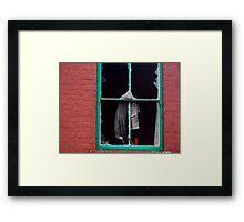 a broken window Framed Print