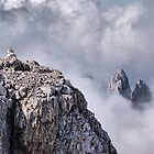 Dolomiti peaks in the clouds by Francesco Malpensi