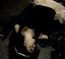 She Lay Unconscious Amongst Dirt And Panic. by Fuschia