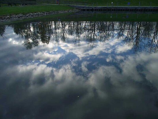 The sky's reflection in the water by Glasseye74