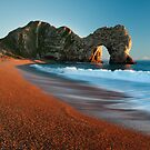 Autumnal sunset at Durdle Door by Kathy White