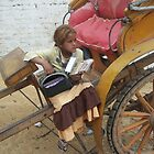Girl selling postcards - Cairo by Jamie Alexander