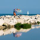 Man with Umbrella on Beach, Caorle, Italy by Petr Svarc