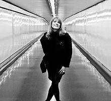 Woman in the metro corridor by Matej Kastelic