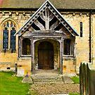 The Entrance Door St John's Church. by Trevor Kersley