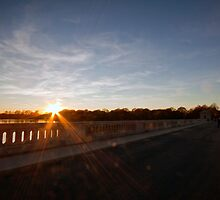 Sunset from the bridge at Silver Lake Park. by Edward Mahala