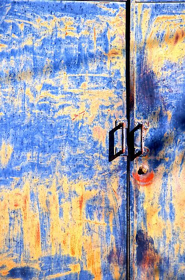 Rusted blue and yellow door by Silvia Ganora