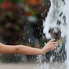 Childs Hand in Water by Michael  Herrfurth