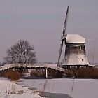 Wind mill in the snow by Willem Hoekstra