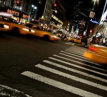 Taxis racing through New York City by dimensions