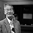 Vietnam - Portrait of elderly man at snooker hall in Dalat by Chris Bishop