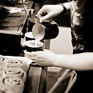 Barista at work making cappuccino by plumchutney