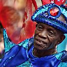 Notting Hill Carnival, gold toothed man by Guy Carpenter