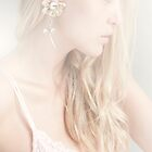 Girl with flower earring by Christinaanaya
