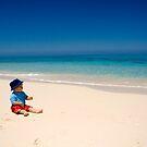 Child playing on Beach, Rose Island, Bahamas by Shane Pinder