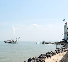Sailing boat arriving at the lighthouse by steppeland