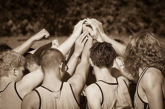 """Team"" - athletes pulling together as a team by John Hartung"