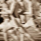 """The Race"" - runners racing by by John Hartung"