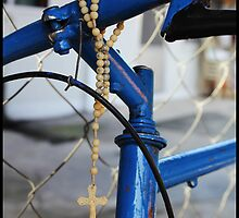 a safe ride on a blue bike by tguerrero