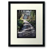 Country road and timber frame house Framed Print