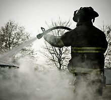 fireman extinguishing car fire by SamuelHaun