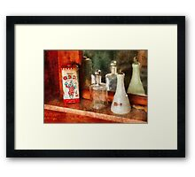 Barber - On a barbers counter  Framed Print