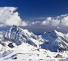 White clouds on mountain tops by Steve plowman