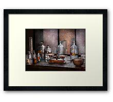 Chemist - The art of measurement  Framed Print