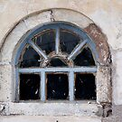 Window in Oia by Lolabud