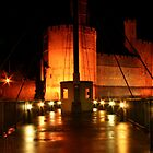 Caernarfon Castle Swing Bridge at Night by AnnDixon