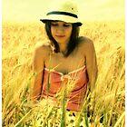 A girl in a field of wheat by fenist