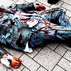 Zombie March in Chicago Dead on the floor by jbsphotography