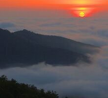 Sunrise Over Cloud Banks by Stephen Vecchiotti