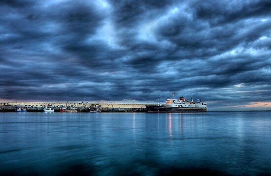 Hebridean Princess in Peel Harbour under a moody sky by RedMann