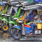 Tuk tuks in the rain by Kevin Hellon