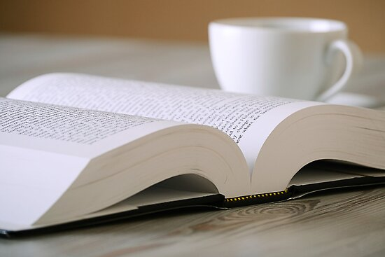 Composition with book and cup of coffee on the table by monticello