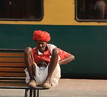 Indian Railway Porter resting, Agra Station by Christopher Cullen