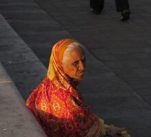 Left behind-old lady in sari at sunset by mypic