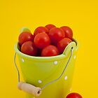 Bucket of cherry tomatoes by Lenka