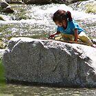 Moroccan Girl Playing on Rock - High Atlas, Morocco by gorecki79