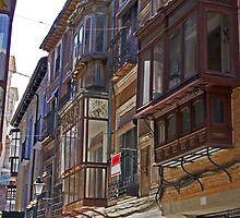 Traditional spanish balconies on old street by IKGM