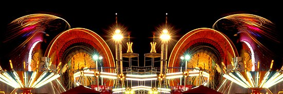 Carnival Rides at Night - Mirrored Image by ©  Paul W. Faust