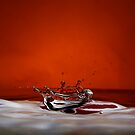 High contrast water spash with red background by John McClumpha