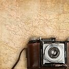 Antique map and photo camera. by Ligak