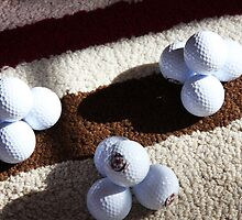 Golf Ball Pyramids by daphsam