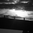 Overpass with sun shining through clouds by Mannabelles