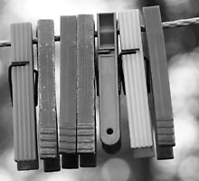 Clothespins on wire by Jouko Mikkola